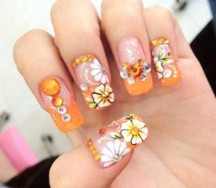 Дизайн ногтей со стразами, оранжевый френч с цветами на нарощенных ногтях